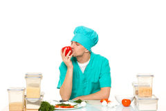 Friendly chef preparing vegetables in his kitchen. pepper loves Stock Images