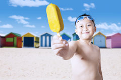 Friendly child offering ice cream Stock Photos