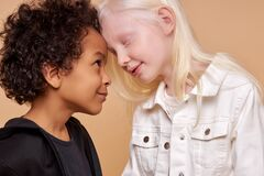Free Friendly Children, Tender African And Albino Kids Royalty Free Stock Images - 184861999