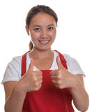 Friendly chinese waitress showing both thumbs up Royalty Free Stock Image