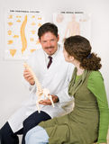 Friendly Chiropractor with Patient Stock Photo