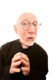 Friendly Clergy. Friendly Priest or Pastor on a White background Stock Photography