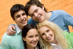 Friendly company. Portrait of friendly students looking at camera with happy smiles Royalty Free Stock Photo