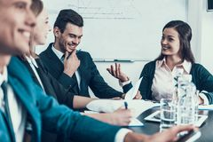 Friendly Company of Business People Work in Conference Room. Business Meeting. Royalty Free Stock Photo