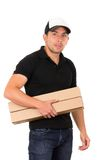 Friendly confident delivery man carrying boxes Stock Photos