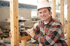Friendly Construction Worker. A friendly, smiling construction worker on the job.   Authentic construction worker on actual construction site Stock Image
