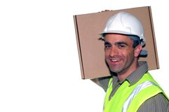 Friendly construction worker. With a package looking into the camera Stock Image