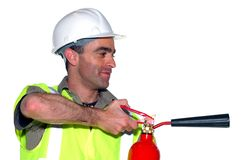 Friendly construction worker. With fire extinguisher Stock Photos