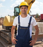 Friendly construction worker in front of his excavator Royalty Free Stock Image