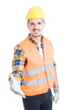 Friendly constructor acting confident and doing hand shake gestu Royalty Free Stock Photography