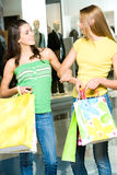 Friendly conversation. Portrait of two women having a conversation in the shopping mall Royalty Free Stock Photography