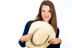 Friendly country girl with a cowboy hat Stock Photos