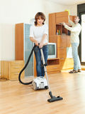 Friendly couple  doing housework together Stock Photography