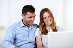 Friendly couple using a laptop Royalty Free Stock Photo