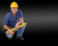 friendly crouch manual worker. Young friendly crouch manual worker carbon fiber background Stock Image