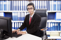 Friendly customer service. Young friendly customer service working at office Stock Images