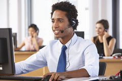 Friendly Customer Service Agent In Call Centre Stock Photos
