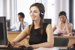 Friendly Customer Service Agent In Call Centre stock photo