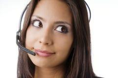 Friendly customer service representative. Attractive friendly customer service representative at work answering phone calls using a headset Royalty Free Stock Photo
