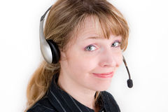 A friendly customer service representative. With a smile against a white background Stock Photos