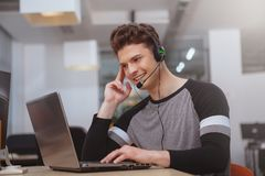 Friendly customer support operator with headset working at call center royalty free stock photos