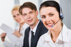Friendly customer support team. In an office environment Royalty Free Stock Images