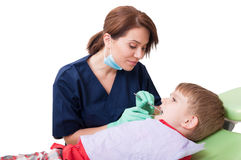 Friendly and cute female dentist and boy patient Stock Photo
