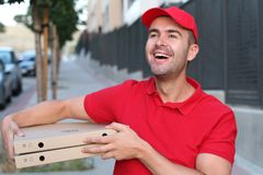 Friendly and cute pizza delivery person stock photography