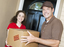 Friendly Delivery Guy and Customer stock image