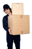 Friendly delivery woman at your doorstep Stock Photos