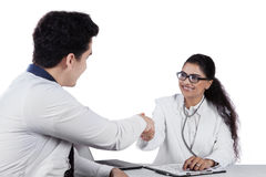 Friendly dentist give greeting to patient Stock Images