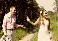 Friendly disagreement. Newlywed couple having friendly disagreement on track in countryside Royalty Free Stock Photography