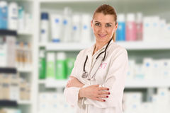 Friendly doctor. Portrait of friendly young doctor over drug store Stock Photos