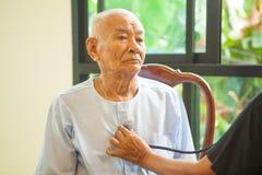 Friendly doctor caring senior man Royalty Free Stock Image