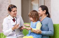 Friendly doctor examining baby Royalty Free Stock Images