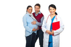 Friendly doctor and future parents royalty free stock photos