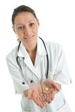 Friendly doctor giving out prescription Royalty Free Stock Photography