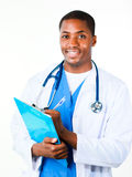 Friendly doctor holding a clipboard Stock Images