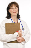 Friendly Doctor Holding Clipboard. Vertical shot of a doctor with her clipboard Stock Image