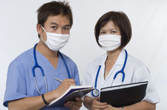Friendly Doctor and Intern Nurse Royalty Free Stock Images
