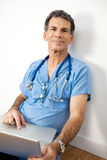 Friendly Doctor with Laptop Royalty Free Stock Images