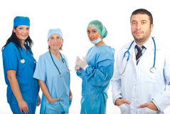 Friendly doctor man and surgeons team royalty free stock images