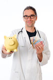 Friendly doctor with money Royalty Free Stock Photography