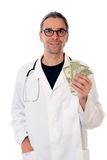 Friendly doctor with money and piggybank Royalty Free Stock Photos