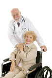 Friendly Doctor & Patient. Friendly mature doctor and his lovely senior patient.  Isolated on white Royalty Free Stock Images