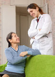 Friendly doctor talks with happy mature woman Royalty Free Stock Image