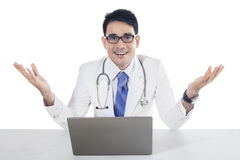 Friendly doctor with welcome gesture Royalty Free Stock Image