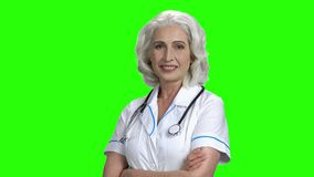 Friendly doctor woman on green screen background. stock video