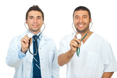 Friendly doctors holding stethoscopes Stock Image