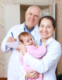 Friendly doctors with little baby Royalty Free Stock Photography